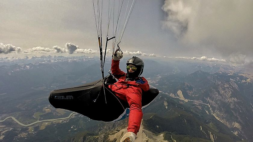 paraglider at cloudbase over Rockies