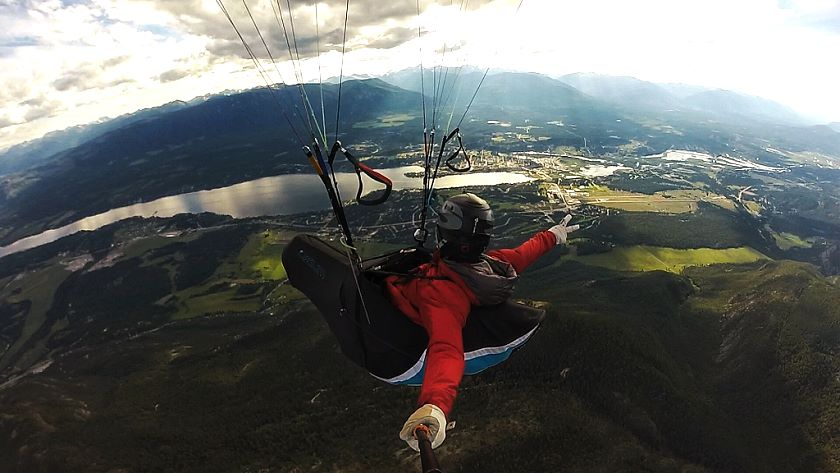 Pilot paraglides over Rockies